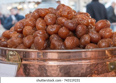 Fresh Brown Candied Chestnuts inside Copper Bowl