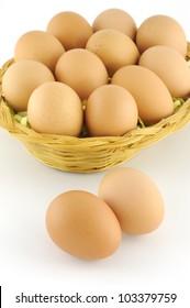 Fresh brown eggs on white background