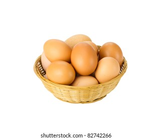 Fresh brown eggs in wicker basket isolated on white