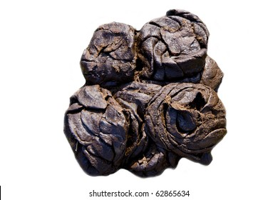Fresh brown smelling horse poop isolated over white