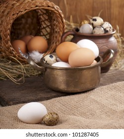 fresh brown and white eggs in  pan on wooden plank