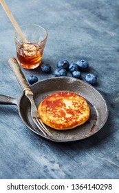 Fresh brunch pancakes with berries and honey