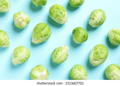 Fresh Brussels sprouts on color background, flat lay