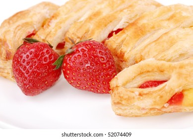Fresh bun and strawberry on white plate