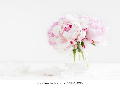 Fresh bunch of pink peonies on light background. Card Concept, copy space for text