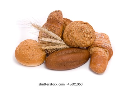Fresh buns and ears of wheat on a white background