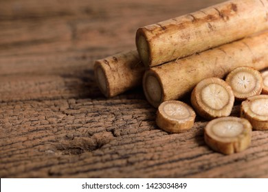 fresh burdock root or Gobo on wooden background