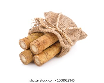 fresh burdock root or Gobo in sack on white background