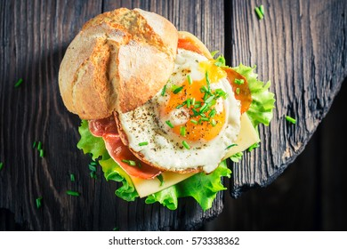 Fresh burger with bacon, eggs and cheese