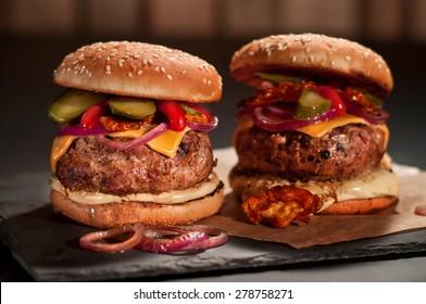 Fresh burger closeup on black slate
