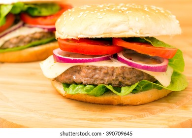 Fresh burger closeup on wooden table