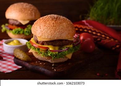 Fresh burger closeup. Wooden rustic background, top view