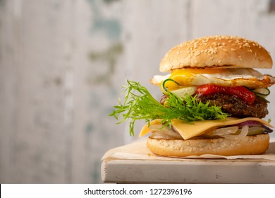 Fresh burger with eggs