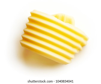 Fresh butter curl isolated on white background, top view