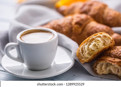 Fresh buttery croissants with coffee. Sweet morning breakfast concept.
