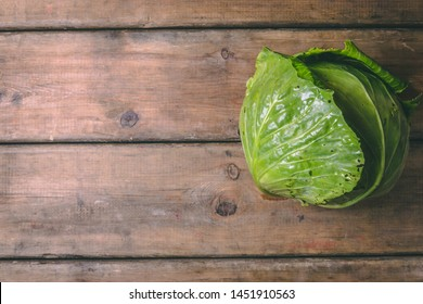 Fresh Cabbage on a wooden rustic table. Copy space. Healthy food. Raw Vegetables.