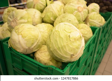 fresh cabbage at the supermarket kiosk. Fresh cabbage on display in the grocery store. cabbage on the shelves in the usual market.