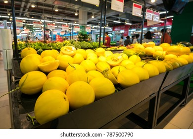 Fresh canary melon on shelf in supermarket.