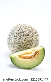 Fresh cantaloupe melon on the white background. Creative layout made of melon. Food concept.