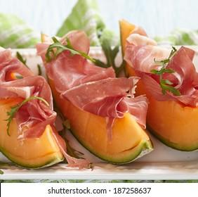 Fresh Cantaloupe Melon with Prosciutto and  Arugula
