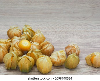 Fresh cape goosebery, physalis, on wooden background