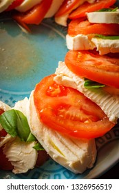 Fresh caprese salad with extra virgin olive oil and salt pepper