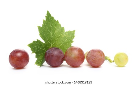 Fresh Cardinal grapes with leaf isolated on white background