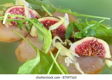 fresh carpaccio salad on green background