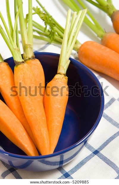 Fresh carrots in the blue bowl