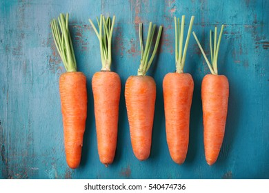Fresh carrots on color background