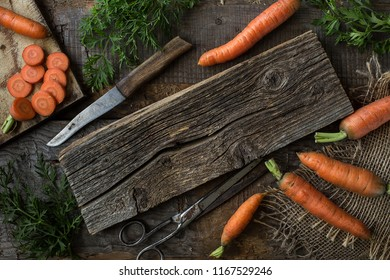 Fresh carrots on dark rustic  background.  Vegetables Vitamins Keratin. Natural organic healthy food concept. Top view with copy space