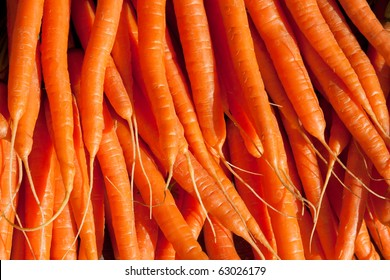 Fresh carrots piled high on a market stall