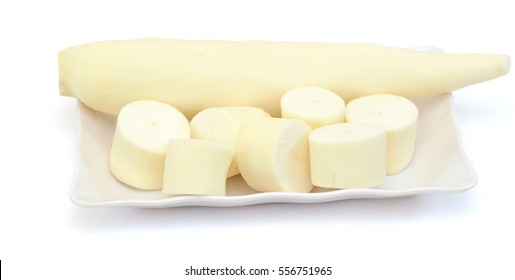 Fresh Cassava on white plate, isolated on a white background