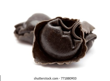 fresh cattlefish ink Tortellini stuffed pasta isolated on white background