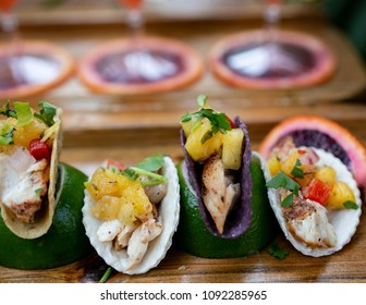Fresh caught fish mini fish tacos with seasonal fruit salsa.