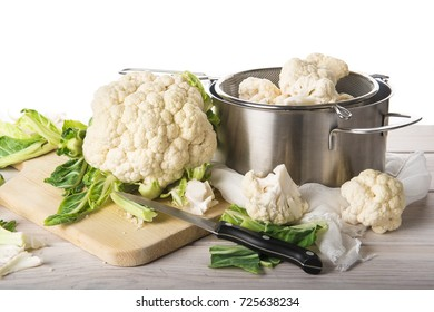 Fresh cauliflower on the table isolated on a white background