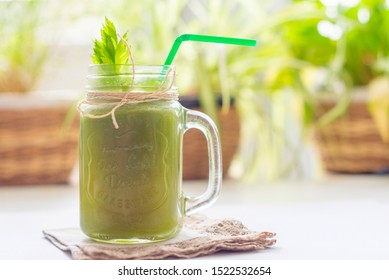 fresh celery juice in a jar on a linen napkin. concept of healthy food and detox