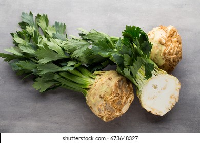 Fresh celery root with leaf isolated on white background.