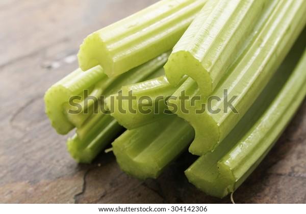 fresh celery sticks on slate background