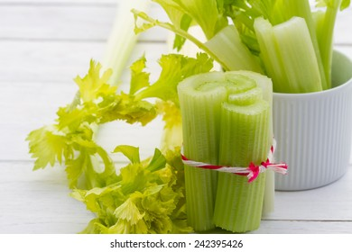 fresh celery sticks organic from natural at on white  wooden table