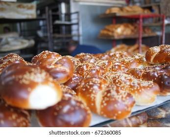 Fresh challah baked in a Jerusalem bakery ready for Shabbat dinner.