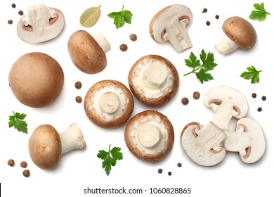 Fresh champignon mushrooms with parsley isolated on white background. top view