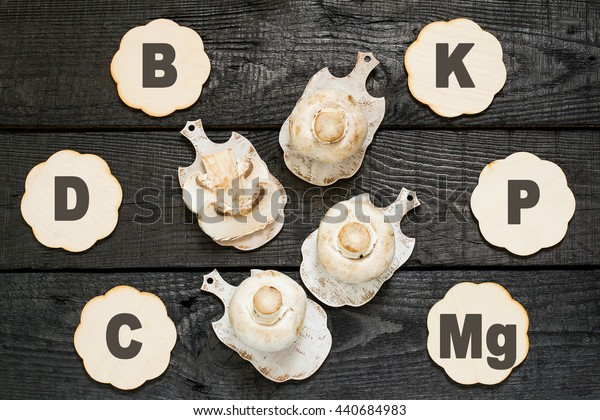 Fresh champignon on a cutting board. The source of vitamins A, C, PP, group B, protein, minerals, amino acids. Diet, health or vegetarian food concept