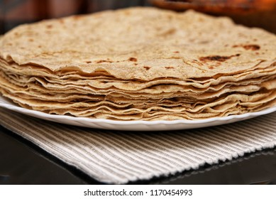 Fresh chapati, chapathi, roti or Indian unleavened flatbread made from organic whole wheat flour or atta. Popular traditional North Indian food homemade. Mumbai India.