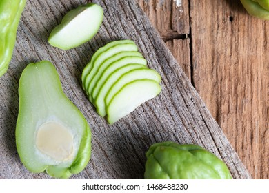 Fresh chayote fruits (Sechium edulis) on wooden background
