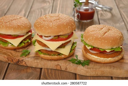 Fresh cheeseburger on a brown background
