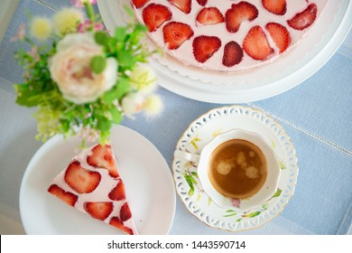 Fresh cheesecake with strawberries on a table