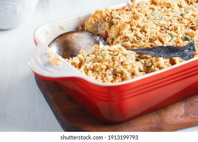 Fresh cheesy tuna casserole with pasta, buttery cracker crumbs and fresh herbs. Could also be used for chicken or ham. Selective focus with blurred background.