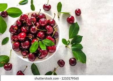 Fresh cherries. Red sweet cherry fruit with leaves