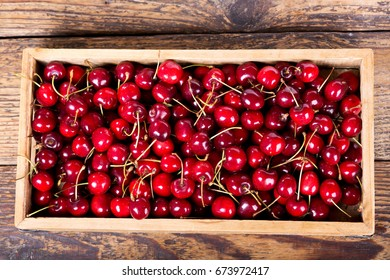 fresh cherries in wooden box on a table